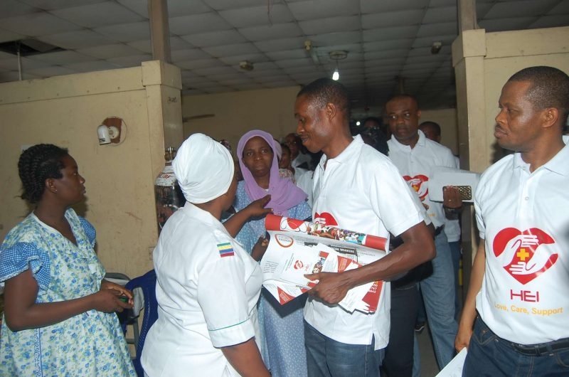Nurse discussing with HEI memebrs at the Hospital