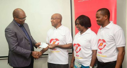 PWc presentation of cheque to HEI, december 2017