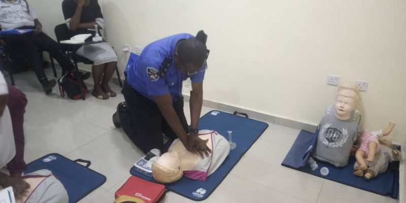 HEI FIRST RESPONDERS PRACTICAL: Police officer giving chest compressions to emergency victims